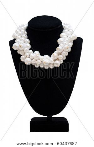 Pearl necklace on black mannequin, isolated on white