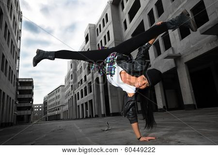 Hip-hop Dancer Girl Posing On The Deserted Streets