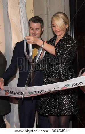 NEW YORK-JAN 28: (L-R) Jeffrey Fowler and Cameron Diaz attend a ribbon cutting at the Tag Heuer Flagship Fifth Avenue store opening on January 28, 2014 in New York City.