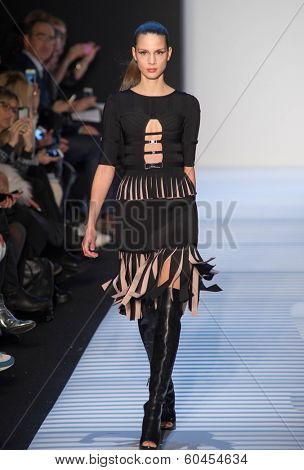 NEW YORK-FEB 8: A model walks the runway at the Herve Leger by Max Azria fashion show during Mercedes-Benz Fashion Week Fall 2014 at Lincoln Center on February 8, 2014 in New York City.