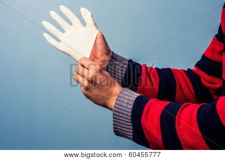 Putting On Rubber Glove
