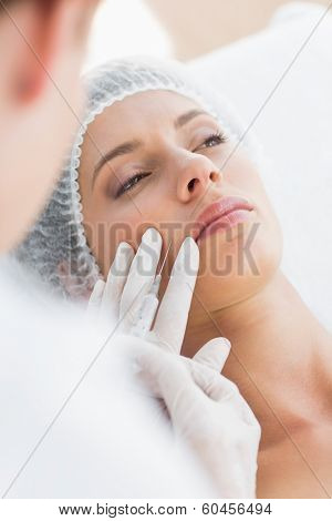 Closeup of beautiful woman recieving injection in upper lip