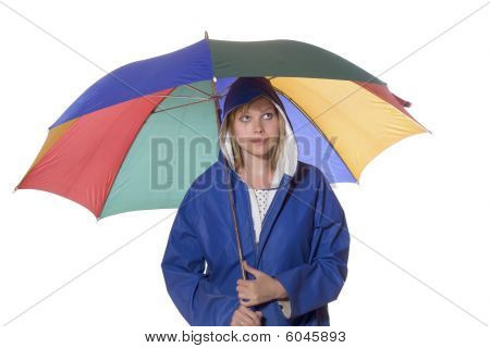 Women In Blue Rain Coat Looking Pessimistic