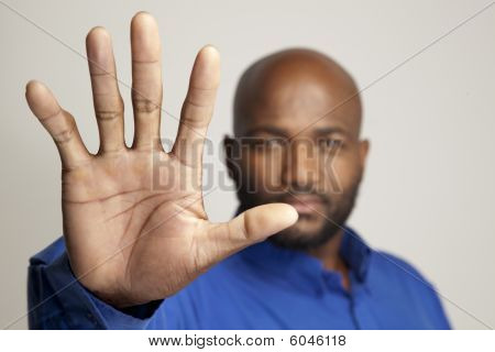 Man gesturing to stop