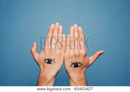 Hands With Eyes Painted On Them
