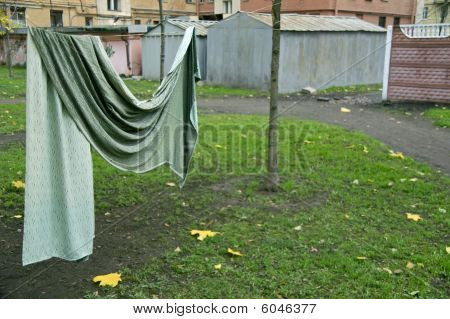 Curtain Drying On String In Backyard