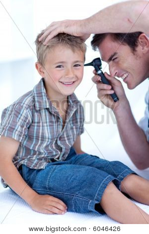 Doctor Checking A Patient' S Ears