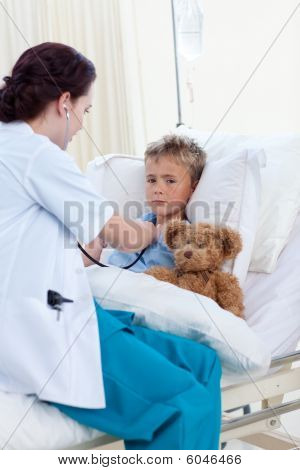 Doctor Listening To A Child Chest With Stethoscope
