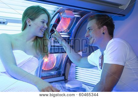 Man And Woman In Tanning Salon At Sunbed