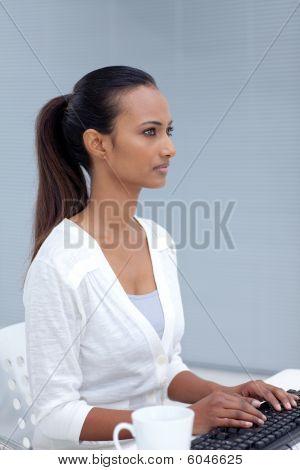 Asian Businesswoman Using A Computer