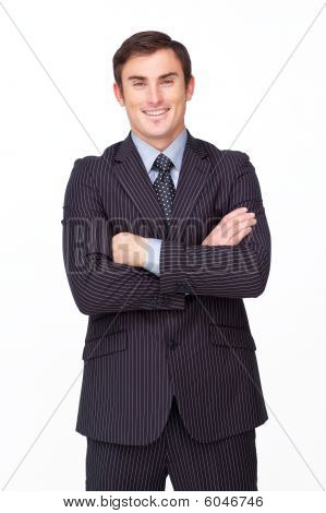 Confident Businessman With Folded Arms Smiling