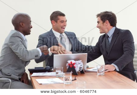 Businessmen In A Meeting Celebrating A Success