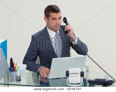 Serious Businessman Phone In His Office