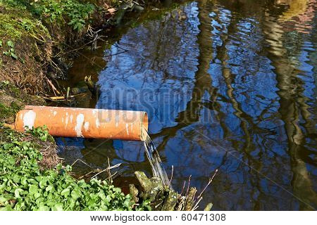 Industrial Pipe Dumping Waste Water Into The River