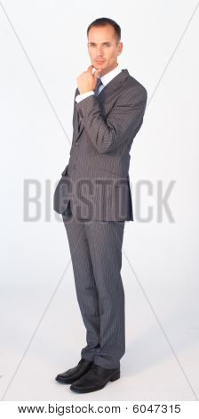 Attractive Confident Businessman Looking At The Camera
