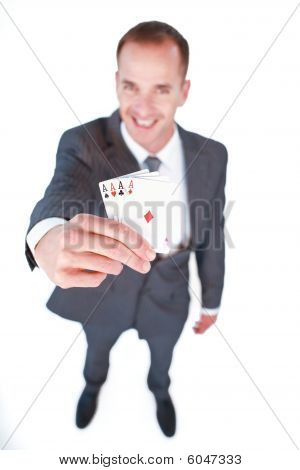 High Angle Of A Smiling Businessman Holding Aces