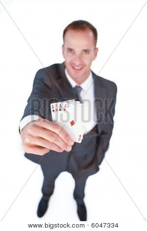 High Angle Of A Businessman Holding Four Aces Poker Cards