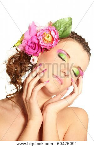 Beautiful girl with flowers in her hair isolated on white