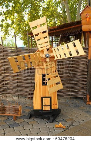 Wooden little windmill at the fair