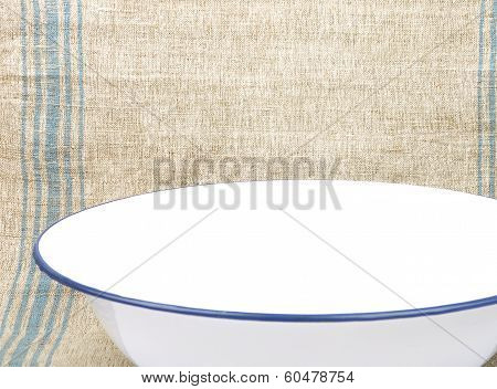 Bowl Of Enamel On Linen Sheet