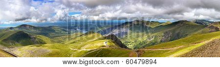 Panorama of the mountains of Snowdonia, looking from Mount Snowdon along the mountain railway track towards the town of Llanberis