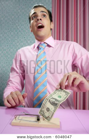 Businessman With Dollar Note On Mouse Trap