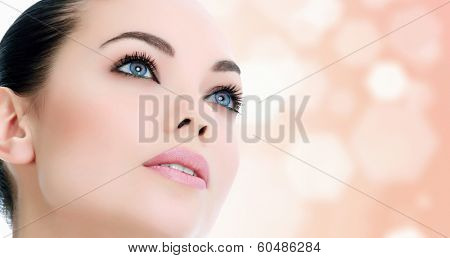 Pretty woman against an abstract background with circles and copyspace