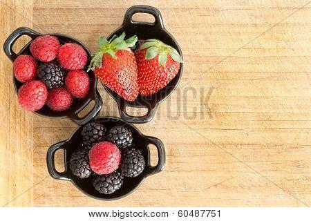 Ramekins Of Healthy Ripe Fresh Mixed Berries