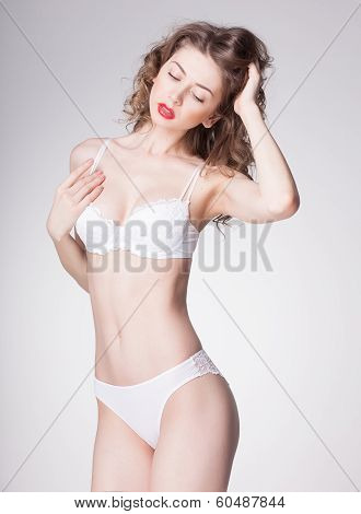 Beautiful Woman Wearing Lingerie - Studio Shot On Grey Background