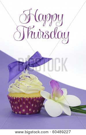 Purple Theme Cupcake With Orchid Flower With Happy Thursday Sample Text Or Copy Space For Your Text