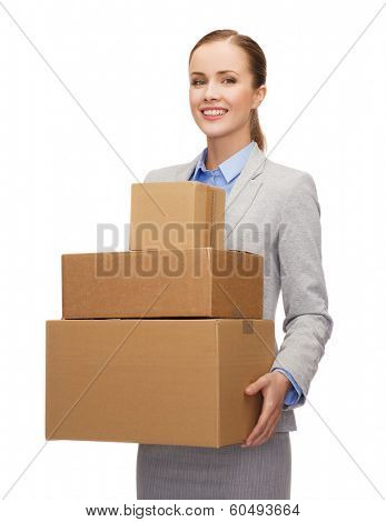 business and delivery service concept - smiling businesswoman holding cardboard boxes