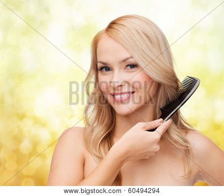 health and beauty concept - beautiful woman with long hair and brush