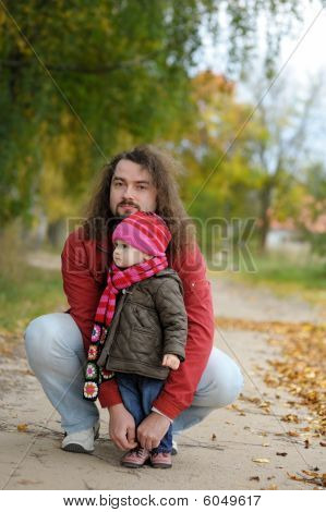 Father And His Baby In An Autumn Park
