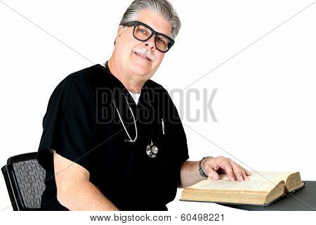 Smiling Medical Doctor Reading A Book