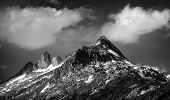 stock photo of snow clouds  - Black and white photo of majestic mountainous landscape - JPG