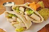 stock photo of pita  - Chicken Caesar Salad in a Pita Pocket with Begetable Tortilla Chips - JPG