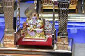 pic of throne  - Ganesha on throne platform placed on swing with glittery frame - JPG