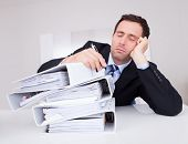 foto of overwhelming  - Bored Businessman Overwhelmed By Paperwork In The Office - JPG