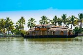 stock photo of houseboats  - beautiful landscape with reflection houseboat in kerala backwaters India - JPG