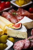 stock photo of cheese platter  - Antipasti and catering platter with different meat and cheese products - JPG