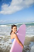 Happy Young Girl With Surfboard