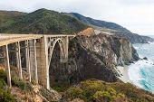 stock photo of pch  - The Historic Bixby Bridge on the Pacific Coast Highway California Big Sur - JPG