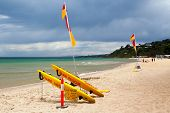 stock photo of lifeguard  - Lifeguard flags on a stormy summer - JPG