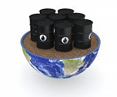 foto of courtesy  - half of an earth globe with a group of oil barrels - JPG