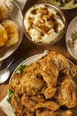 stock photo of southern fried chicken  - Homemade Southern Fried Chicken with Biscuits and Mashed Potatoes - JPG