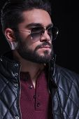 stock photo of long beard  - closeup portrait of a bearded casual young man with sunglasses - JPG