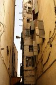Fes (fez) Is Consist Of Thousants Small Streets Like This One. Houses Are Mande One On Top The Old O