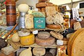 BRA, ITALY - SEPTEMBER 22, 2013: Different mature hard cheese types on the stand. Hard cheese (granu