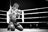 CHANG, THAILAND - FEB 22, 2013: Unidentified Muaythai fighter in ring during match (black and white