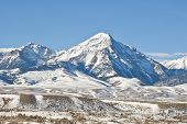 foto of blanket snow  - Winter blankets the Lemhi Valley and Mountain Range with Diamond Peak rising into the sky - JPG